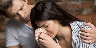 image of a couple in tears