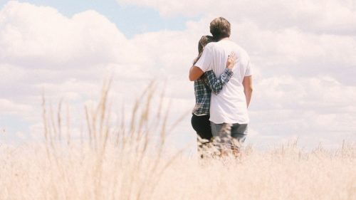 couple in a grassland