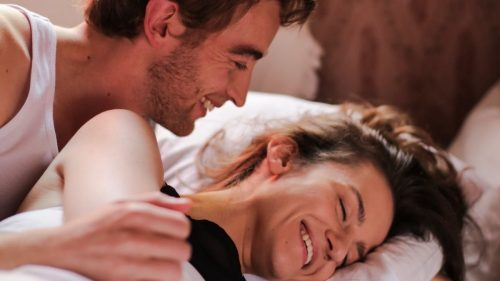 playful couple in the bed
