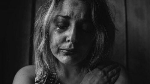 a sad and crying woman