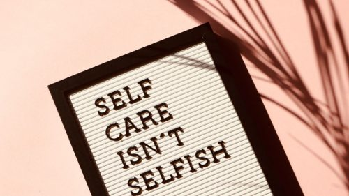 self care isnt selfish text on white background