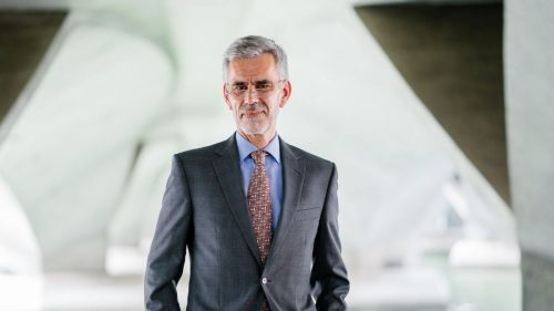 man with grey hair wearing suit